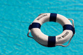 Life buoy in the swimming pool — Stock Photo