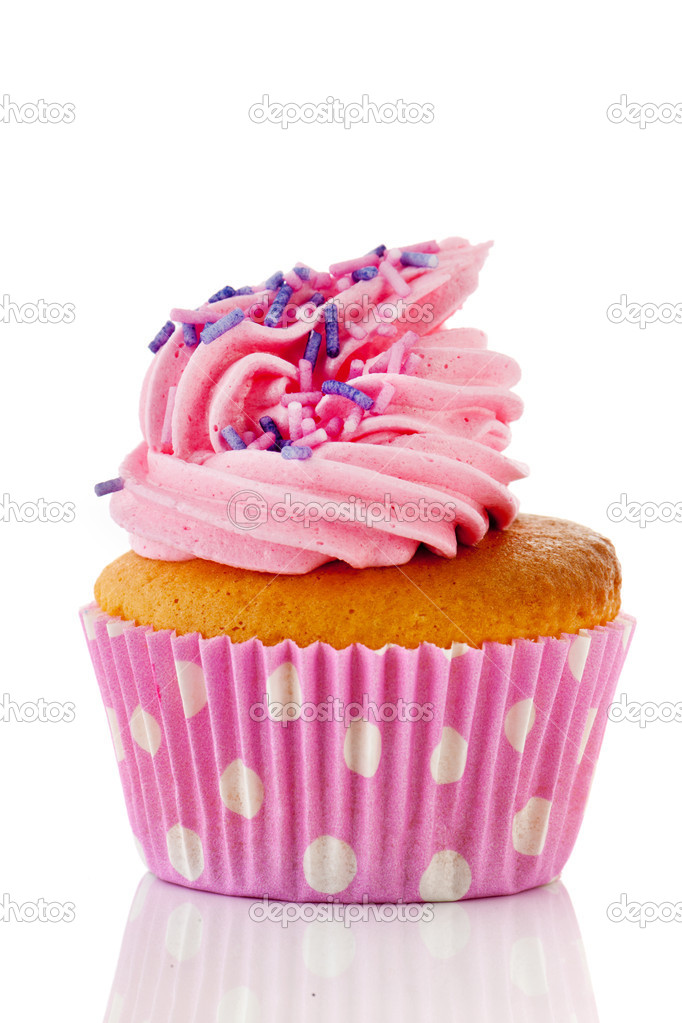 Pink cupcake with sprinkles and blue flower isolated over white background — Stock Photo #10817760
