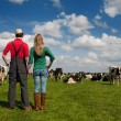 Typical Dutch landscape with farmer couple and cows — Stock Photo #11470279