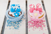 Cupcake for a baby girl and boy — Stock Photo