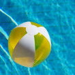 Inflatable beach ball in water — Stock Photo