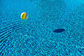 Floating ball in swimming pool — Stock Photo