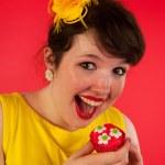 Woman eating cupcakes — Stock Photo #12189936