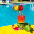 Cocktail drink at swimming ppol — Stock Photo #12416083