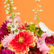Bouquet flowers on orange — Stock Photo