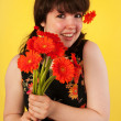 Teen girl with flowers — Stock Photo