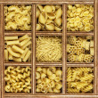 Different kinds of italian pasta in wooden box catalog — Foto de Stock