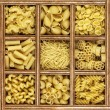 Different kinds of italian pasta in wooden box catalog — Stockfoto