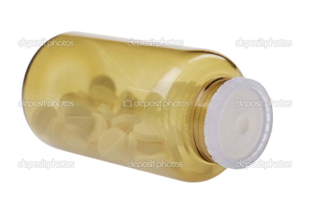 Closed brown jar with pills. isolated on white background  Stock Photo #11098808