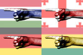 Set of pointing finger in national flags — 图库照片