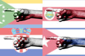 Set of pointing finger in national flags — Stock fotografie