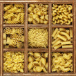 Different kinds of italian pasta in wooden box catalog — Stock Photo #11531475
