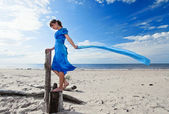Young woman in blue dress — Stock Photo