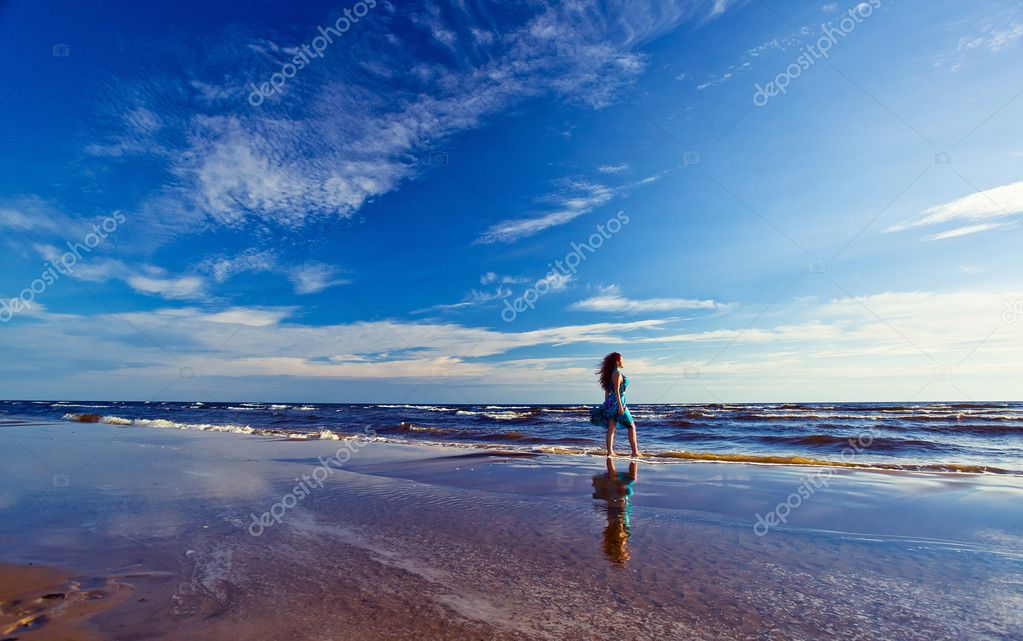 The young beautiful woman on a beach. Focal length 17 mm .The polarising filter is used.  Stock Photo #11836531