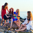Girls on seacoast — Stock Photo