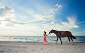 Beautiful girl with horse on seacoast — Zdjęcie stockowe