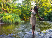 Girl in river — Stock Photo