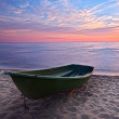Sunset.Boat on coast. — Stock Photo #12257571