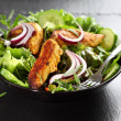 Salad with marinated chicken breast stripes — Stock Photo