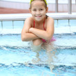 Child relaxing by swimming pool — Stock Photo #11070390