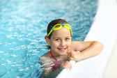Girl with goggles in swimming pool — Foto Stock
