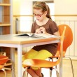 Stock Photo: School girl studying in library