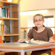 School girl in library — Stock Photo