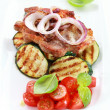 Pan-fried pork steak with grilled vegetable — Stock Photo