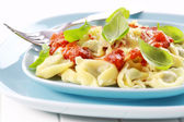 Tortellini with tomato sauce and cheese — Stock Photo