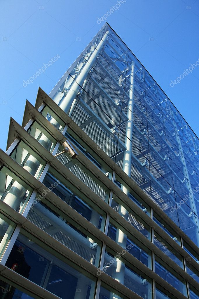 Modern glass building in blue tone — Stock Photo #11492327