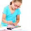 Schoolgirl painting with watercolor — Stock Photo #11576771