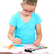 Schoolgirl painting with watercolor — Stock Photo #11576794