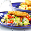 Fried fish on vegetables - Stok fotoğraf