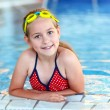 Girl with goggles in swimming pool - Photo