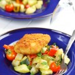 Fried fish fillet on vegetables - Foto de Stock