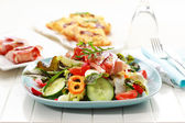 Vegetable salad with prosciutto rolls — Stock Photo