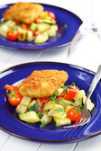 Fried fish fillet on vegetables — Stock Photo
