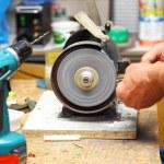 Man working with sharpening machine tool — Stock Photo