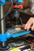 Man working on drilling machine — Stock Photo