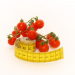 Mini tomatoes with measure - Stock Photo
