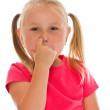Little girl picking her nose — Stock Photo #11637585