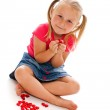 Little girl with red hearts — Stock Photo #11637617