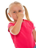 Little girl covering nose — Foto Stock