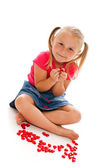 Little girl with red hearts — Stock Photo