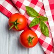 Fresh basil leaves and tomatoes - Stock Photo