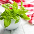 Fresh basil leaves in a mortar - Stock Photo
