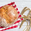 Crusty bread with wheat — Stock Photo