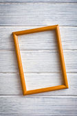 Wooden picture frame on old wooden background — Stock Photo