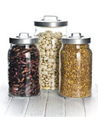 Various legumes in the jars — Foto Stock