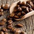 Coffee beans in wooden scoop — Foto de Stock